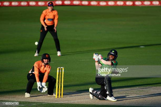 Deepti Sharma of Western Storm hits out while Carla Rudd of Southern Vipers looks on during the Kia Super League 2019 Final between Western Storm and...