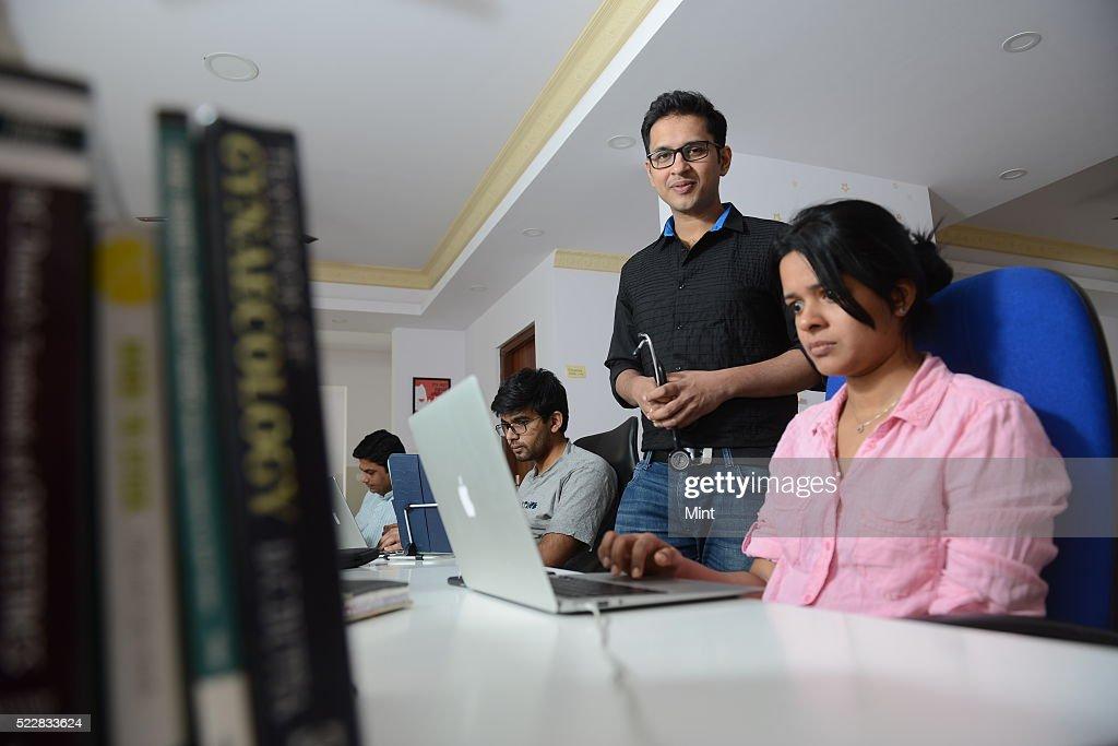 Deepu Sebin Co-Founder of Start-up app Dailyrounds posing on