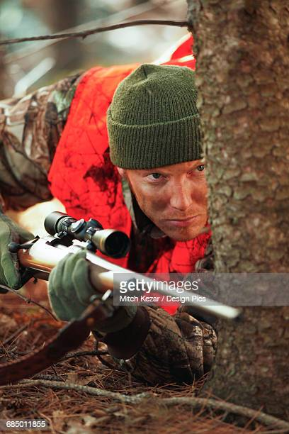 Deer Hunter Stalking With Rifle