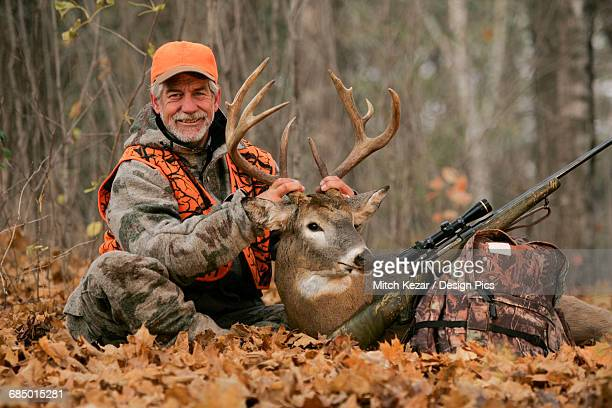 deer hunter with dead deer - dead deer stock photos and pictures