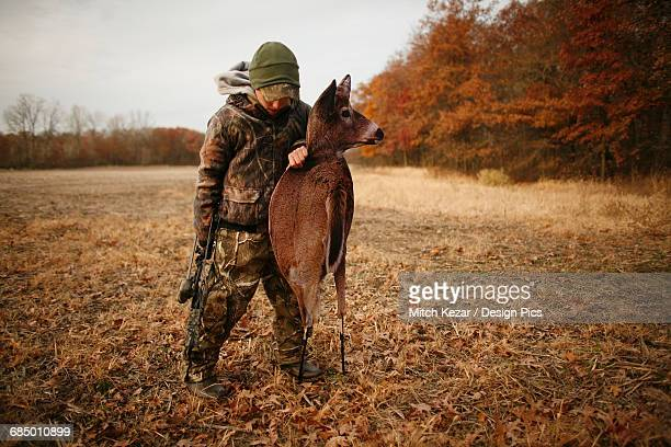 deer hunter with deer decoy - white tail deer stock photos and pictures