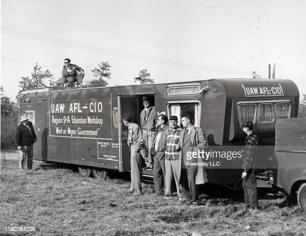 Members of UAWCIO union stand near the union's trailer for strikers of Fairchild engine division in Deer Park New York on April 4 1956