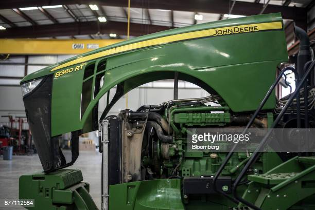 A Deere Co John Deere 8360 RT tractor sits in the workshop at a United Ag Turf dealership in Waco Texas US on Monday Nov 20 2017 Deere Co is...