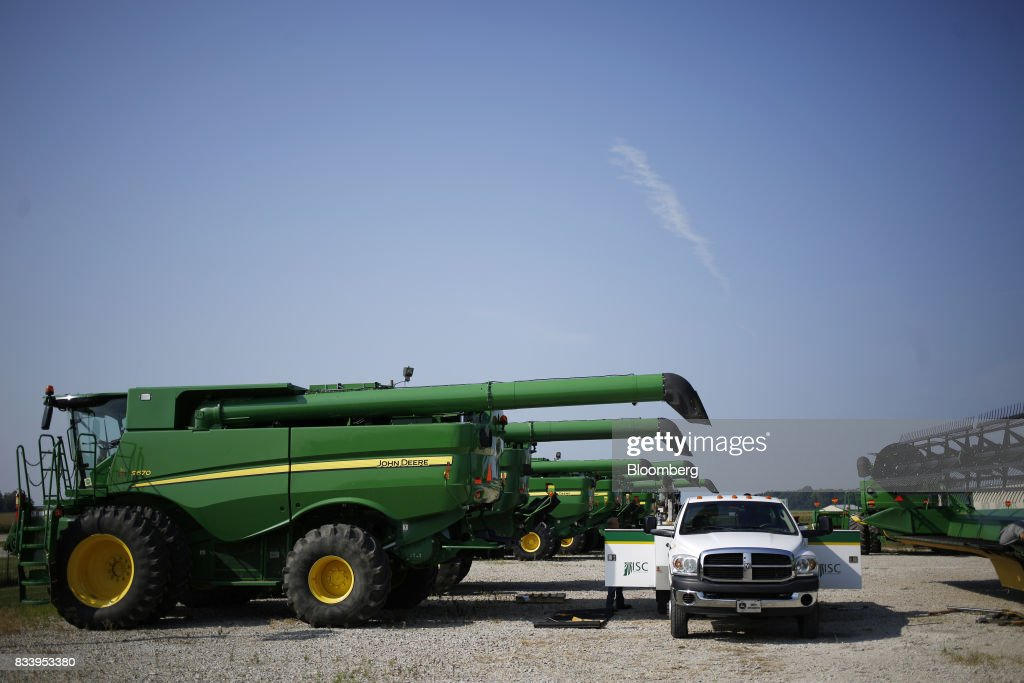 Deere & Co. John Deere combine harvesters sit on display for sale at the Smith Implements Inc. dealership in Greensburg, Indiana, U.S., on Wednesday, Aug. 16, 2017. Deere & Co. is scheduled to release earnings figures on August 18. Photographer: Luke Sharrett/Bloomberg via Getty Images
