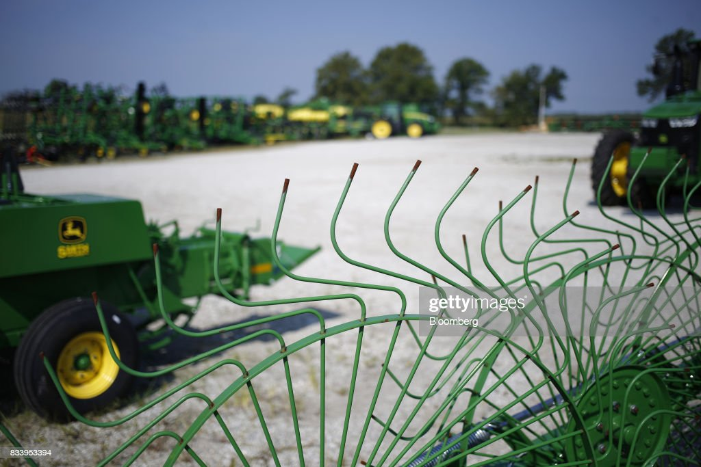Deere & Co. John Deere farm machinery sit on display for sale at the Smith Implements Inc. dealership in Greensburg, Indiana, U.S., on Wednesday, Aug. 16, 2017. Deere & Co. is scheduled to release earnings figures on August 18. Photographer: Luke Sharrett/Bloomberg via Getty Images
