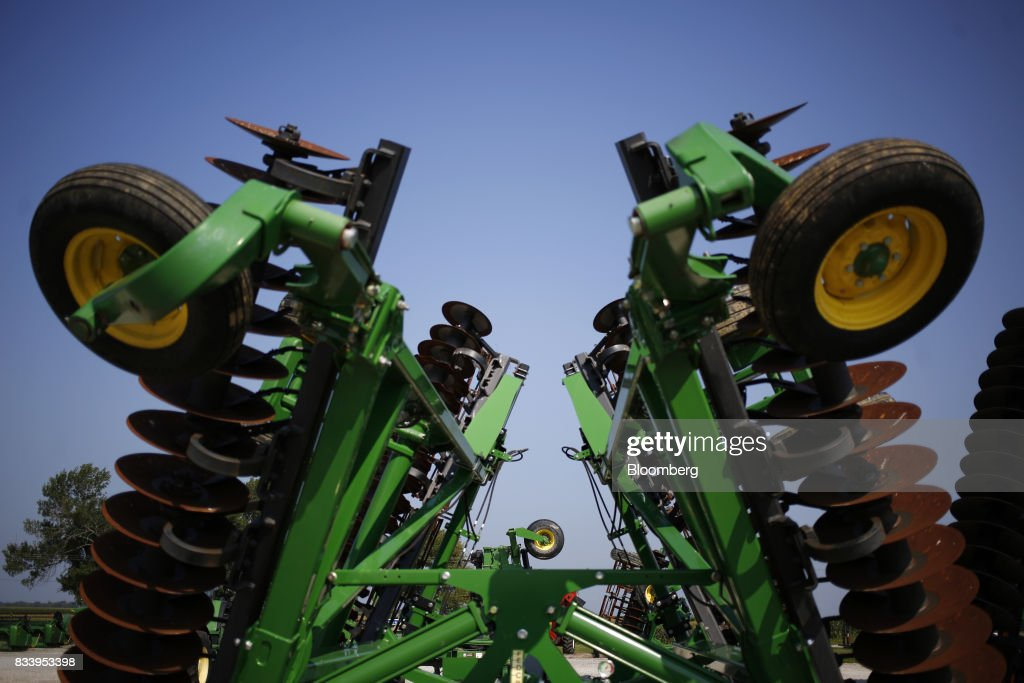 Deere & Co. John Deere farm machinery sits on display for sale at the Smith Implements Inc. dealership in Greensburg, Indiana, U.S., on Wednesday, Aug. 16, 2017. Deere & Co. is scheduled to release earnings figures on August 18. Photographer: Luke Sharrett/Bloomberg via Getty Images