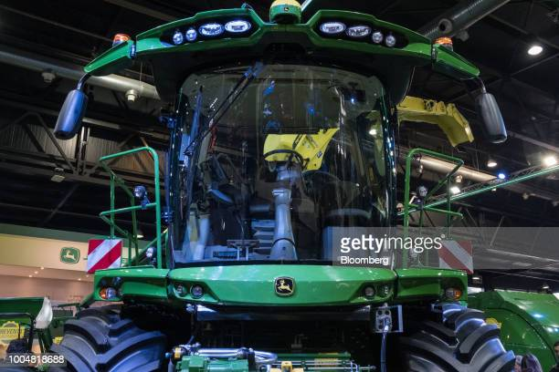 A Deere Co John Deere forage harvester sits on display at the exhibition pavilion during La Exposicion Rural agricultural and livestock show in the...