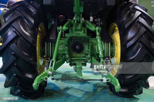 A Deere Co John Deere tractor sits on display at the exhibition pavilion during La Exposicion Rural agricultural and livestock show in the Palermo...