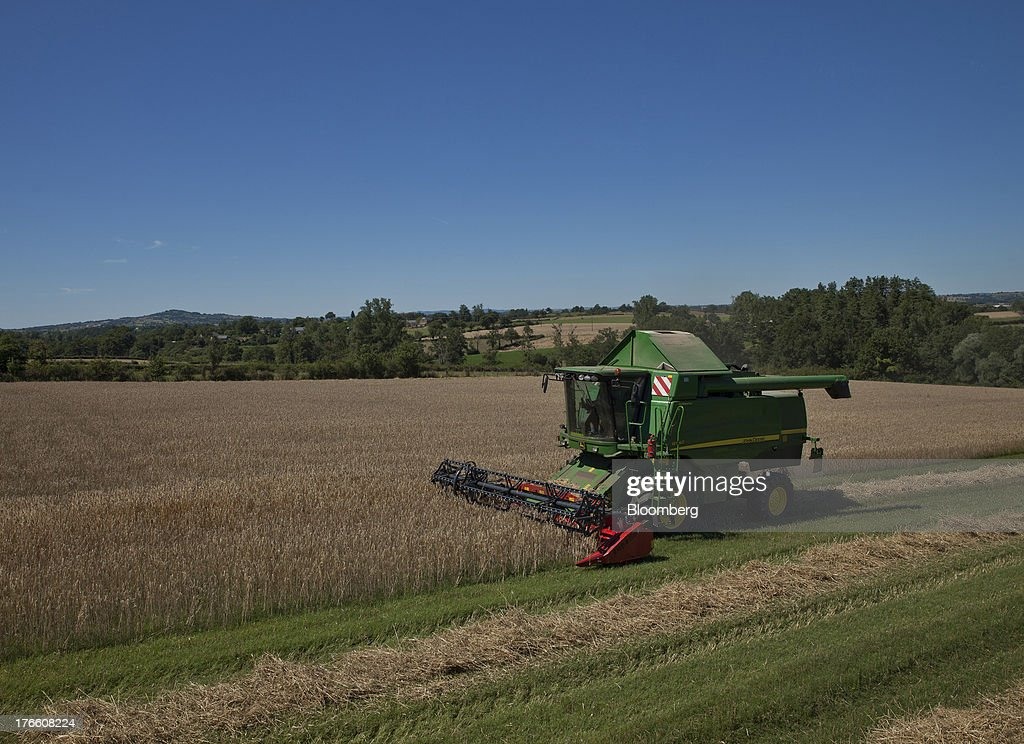 A Deere & Co. John Deere W540 combine harvester operates in a field of triticale wheat during a harvest in Ceras, southwest France, on Thursday, Aug. 15, 2013. French farmers harvested better-quality wheat than expected north and east of Paris, making up for low protein content in the southwest and raising confidence the grain will meet export requirements. Photographer: Balint Porneczi/Bloomberg via Getty Images