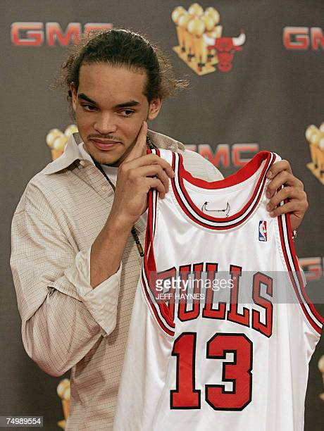 Joakim Noah the first round draft pick of the Chicago Bulls holds his jersey 02 July 2007 at the Chicago Bulls Berto Center practice facility in...