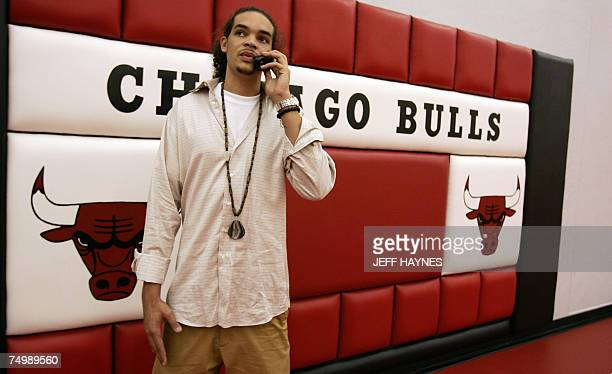 Joakim Noah the first round draft pick of the Chicago Bulls talks on the phone 02 July 2007 at the Chicago Bulls Berto Center practice facility in...