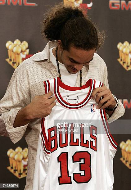 Joakim Noah the first round draft pick of the Chicago Bulls looks at his jersey 02 July 2007 at the Chicago Bulls Berto Center practice facility in...