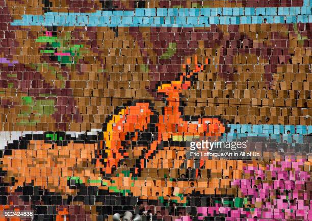 Deers made by human pixels holding up colored boards during Arirang mass games in may day stadium Pyongan Province Pyongyang North Korea on September...