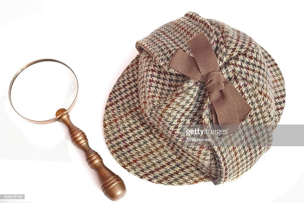 Deerstalker Hat And Magnifying Glass On Wooden Table : Stock Photo