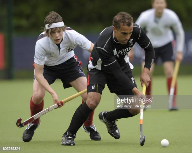 Deeside's Trevor Merrick is closed down by Brooklands MU's David Flanagan during their promotion tournament game at Cannock Hockey Club Cannock