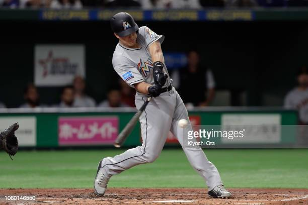 Deesignated hitter JT Realmuto of the Miami Marlins hits a solo home run in the top of 4th inning during the game three of Japan and MLB All Stars at...