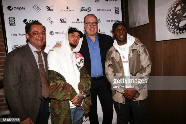 Def Jam executive Faisel Durrani Amir Obe Def Jam CEO Steve Bartels and Gordon Dillard attend the Def Jam Upfronts 2017 showcase at Kola House on May...