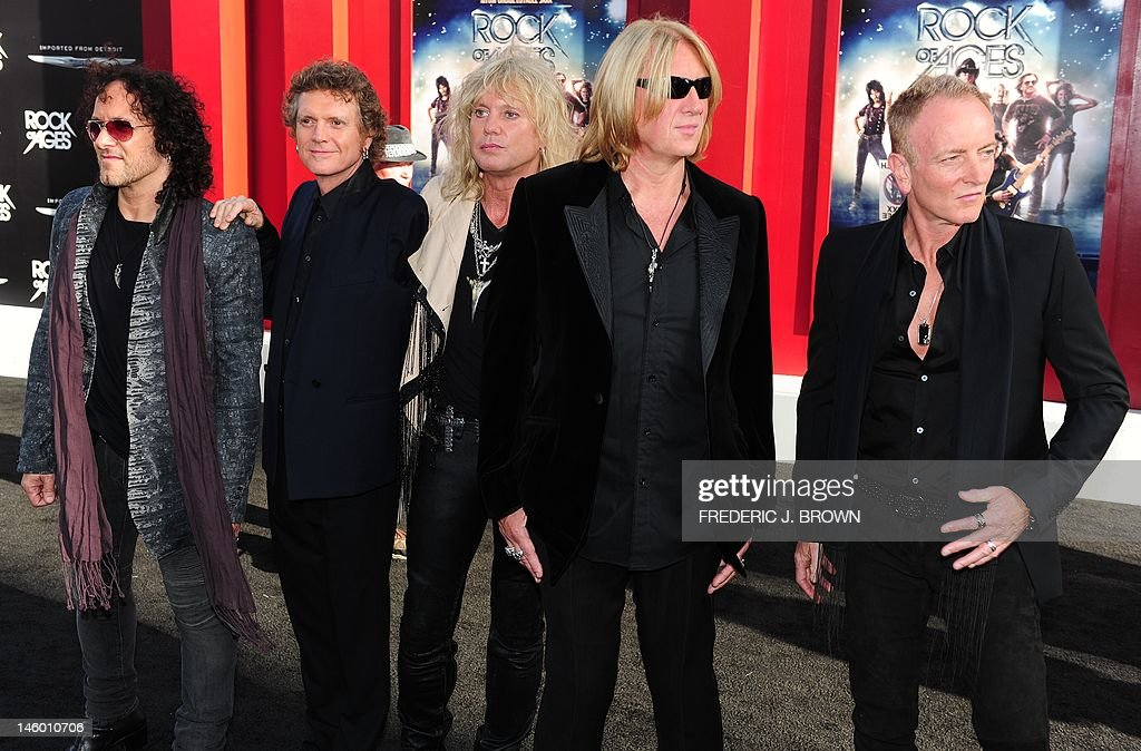 Def Leppard arrive for the world premier : News Photo