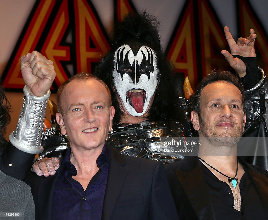Def Leppard member Phil Collen, KISS member Gene Simmons and Def Leppard member Vivian Campbell attend the KISS and Def Leppard press announcement at House of Blues on March 17, 2014 in Los Angeles, California.