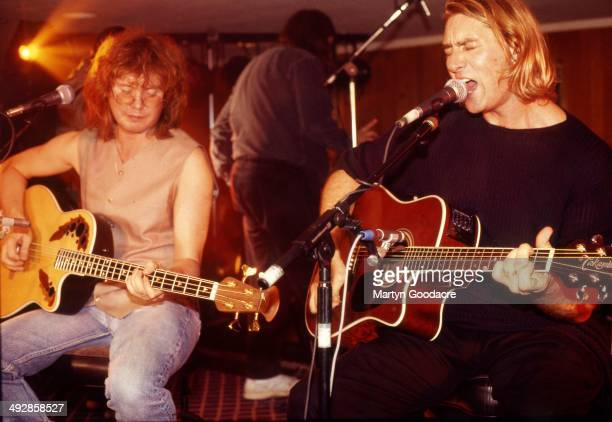 Def Leppard perform an acoustic show at Wapentake Club, Sheffield, United Kingdom, 5th October 1995. L-R Rick Savage and Joe Elliott .