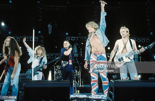 Def Leppard perform on stage at Freddie Mercury Tribute Concert, Wembley, London, 20th April 1992, L-R Vivian Campbell, Rick Savage, Rick Allen, Joe...