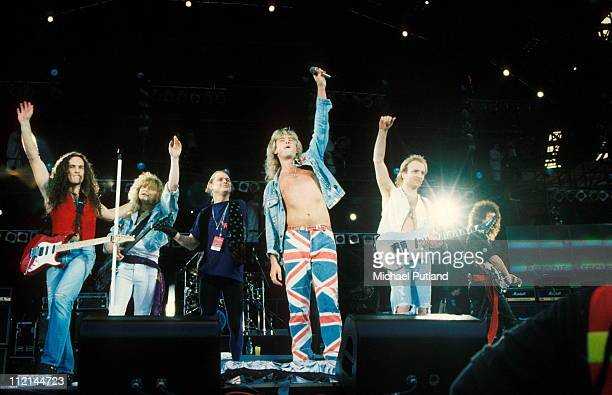 Def Leppard perform on stage with Brian May at Freddie Mercury Tribute Concert Wembley London 20th April 1992 LR Vivian Campbell Rick Savage Rick...