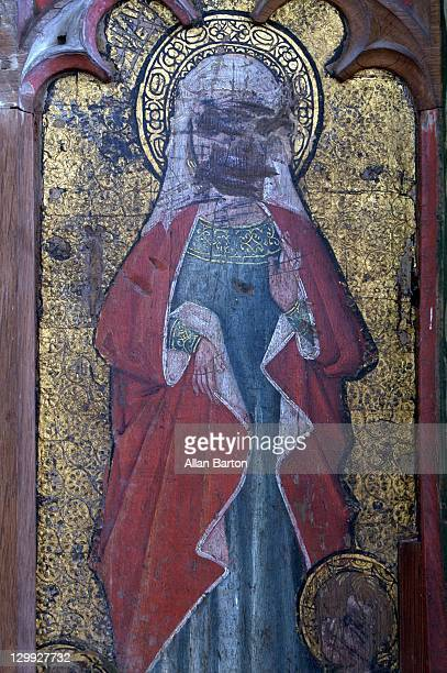 Defaced fifteenth century rood screen. North side: the Holy Kindred. St Mary Cleopas with four boys at her feet, her sons the Apostles Simon, Jude,...