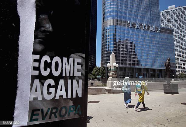 A defaced recruiting flyer for Identity Evropa hangs near Trump Tower on July 6 2016 in Chicago Illinois The flyer which read Let's Become Great...