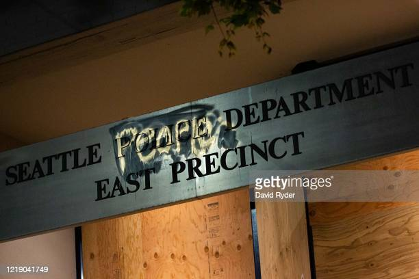 Defaced sign on the exterior of the Seattle Police Departments East Precinct is seen on June 9, 2020 in Seattle, Washington. Protests have continued...