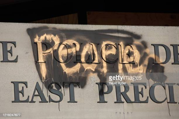 """Defaced sign with People"""" painted over Police"""" is seen on the exterior of the Seattle Police Departments East Precinct in the so-called """"Capitol Hill..."""