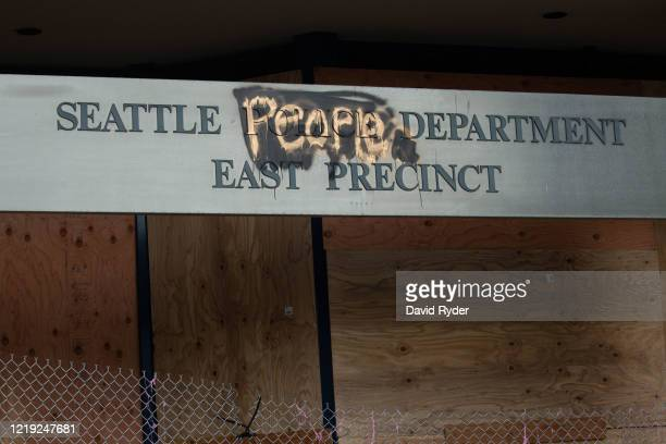 "Defaced sign with People"" painted over Police"" is seen on the exterior of the Seattle Police Departments East Precinct in the so-called ""Capitol Hill..."