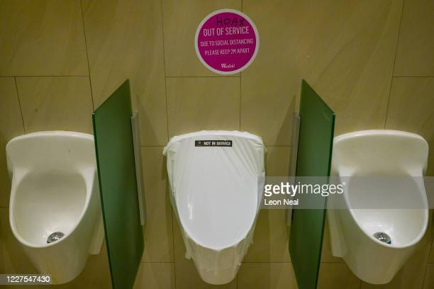 A defaced social distancing sticker with the word HOAX written across it is seen above urinals in a men's toilet on May 28 2020 in London United...