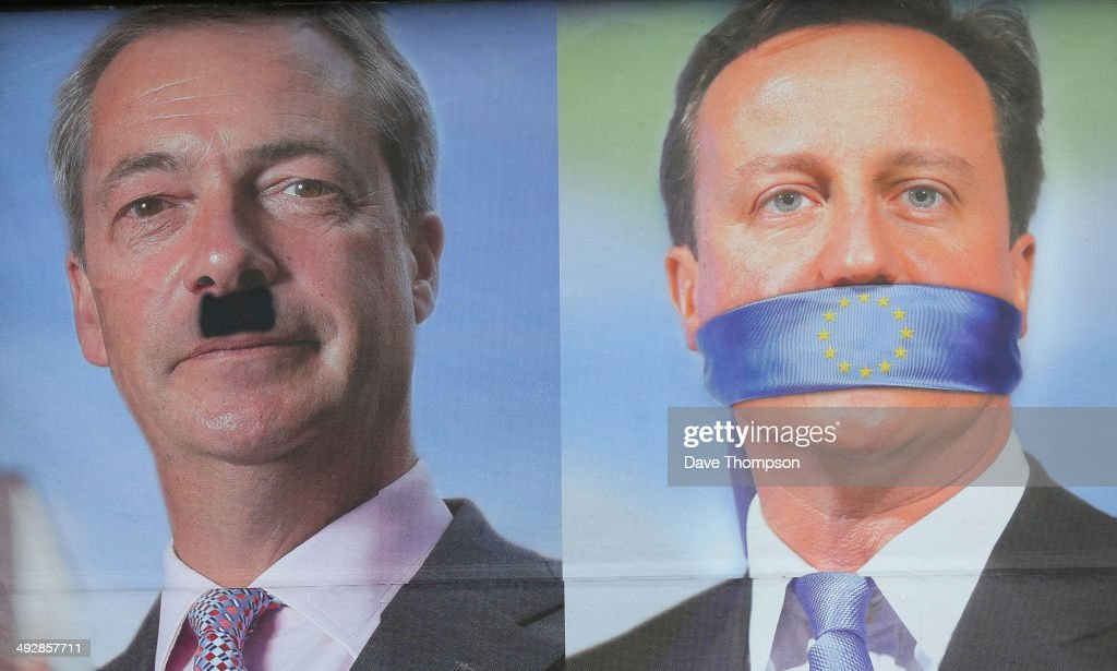 A defaced UKIP poster showing the faces of Nigel Farage and David Cameron on May 22, 2014 in Sheffield, England. Voters across Europe are taking to the polls to vote in the elections for the European Parliament as well as local council elections in England and Northern Ireland.