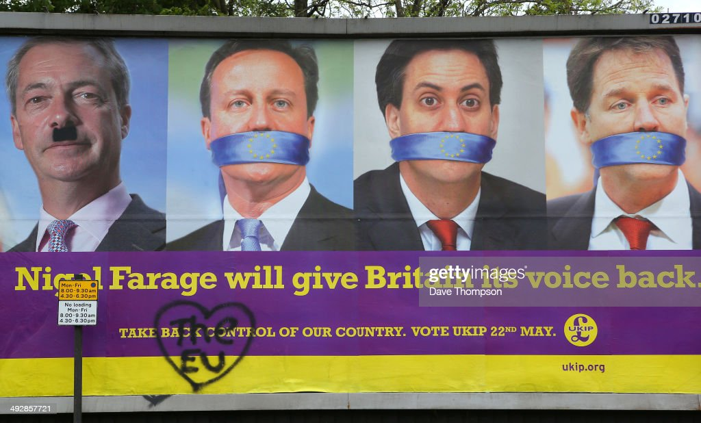 A defaced UKIP poster showing the faces of Nigel Farage, David Cameron, Ed Miliband and Nick Clegg on May 22, 2014 in Sheffield, England. Voters across Europe are taking to the polls to vote in the elections for the European Parliament as well as local council elections in England and Northern Ireland.