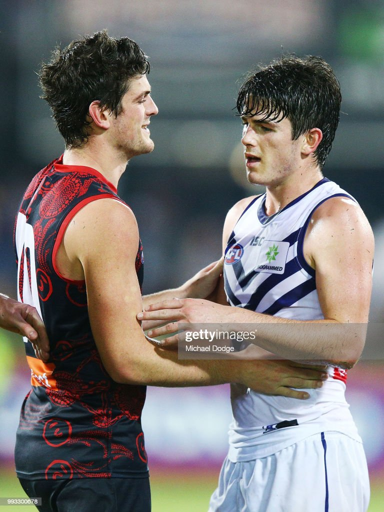 A defeated Andrew Brayshaw of the Dockers (R) hugs brother Angus Brayshaw of the Demons during the round 16 AFL match between the Melbourne Demons and the Fremantle Dockers at TIO Stadium on July 7, 2018 in Darwin, Australia.