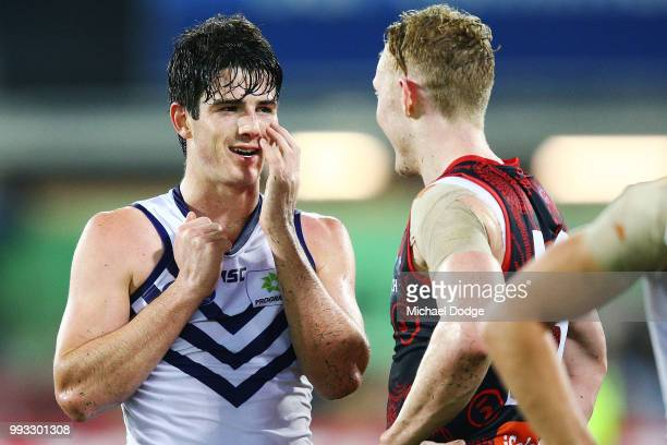 A defeated Andrew Brayshaw of the Dockers talks gestures to his face with Clayton Oliver of the Demons during the round 16 AFL match between the...