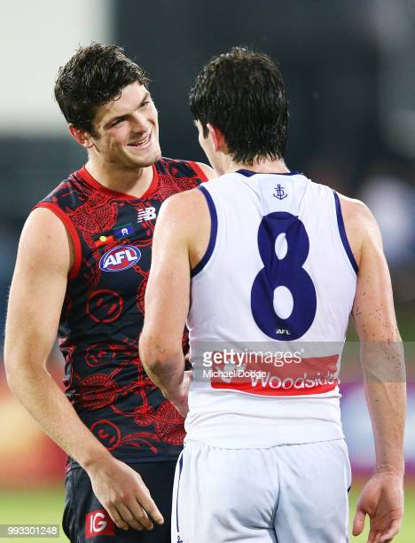 A defeated Andrew Brayshaw of the Dockers talks with brother Angus Brayshaw of the Demons during the round 16 AFL match between the Melbourne Demons...
