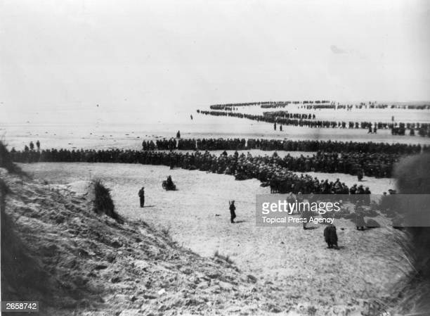 Defeated British and French troops waiting on the dunes at Dunkirk to be picked up by the Destroyers and taken back to England