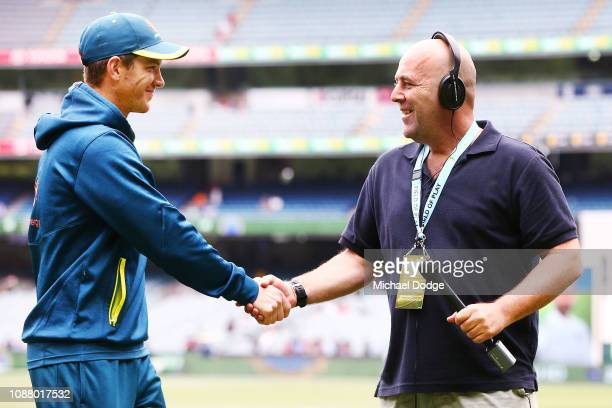 A defeated Captain Tim Paine of Australia shakes the hand of former Australian Cricket head coach Darren Lehmann during day five of the Third Test...
