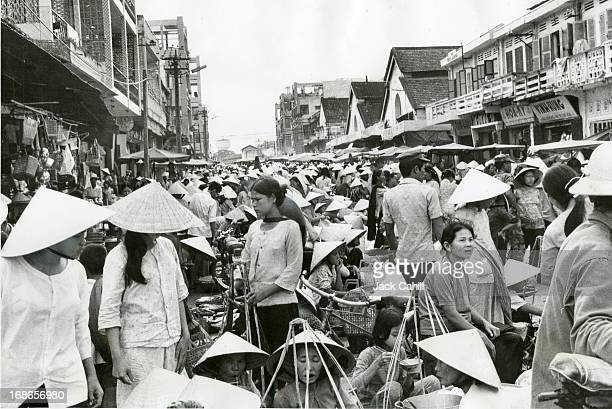 Defeated in Da Nang south Vietnamese survivors wait for aid cut off by Communist shelling While some stood patiently trapped in the fallen city...