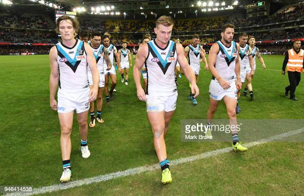 Defeated Port players leave the ground during the round four AFL match between the Essendon Bombers and the Port Adelaide Power at Etihad Stadium on...