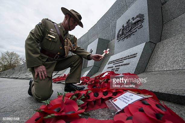 Defence Chief of Staff at the Australian High Commission London Graham Price lays a remeberance cross at the Australian war memorial during Anzac Day...