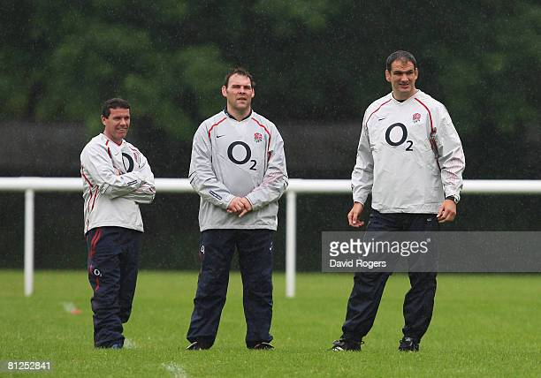 Defence Coach Mike Ford Forwards Coach John Wells and Martin Johnson the England Manager look on during an England training session at Bath...