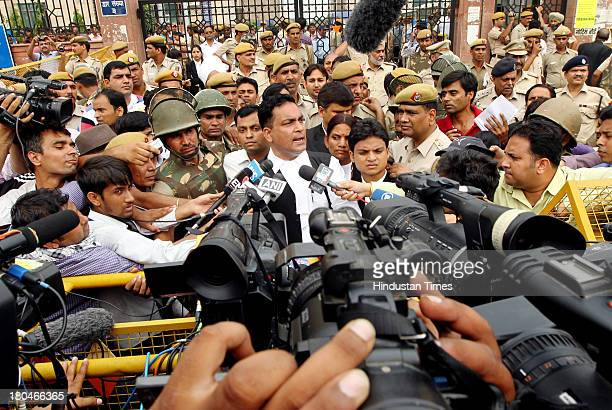 Defence lawyer AP Singh addresses the media outside the Saket Court complex following the sentencing of four men convicted of rape and murder on...