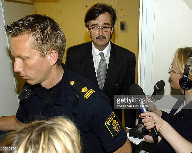 Defence Lawyer Gunnar Falk leaves the court room 19 September 2003, after Stockholm's district court ordered the continued detention of his client,...