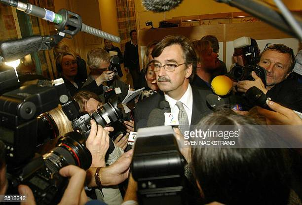 Defence Lawyer Gunnar Falk speaks to reporters after leaving the court room 19 September 2003, after Stockholm's district court ordered the continued...
