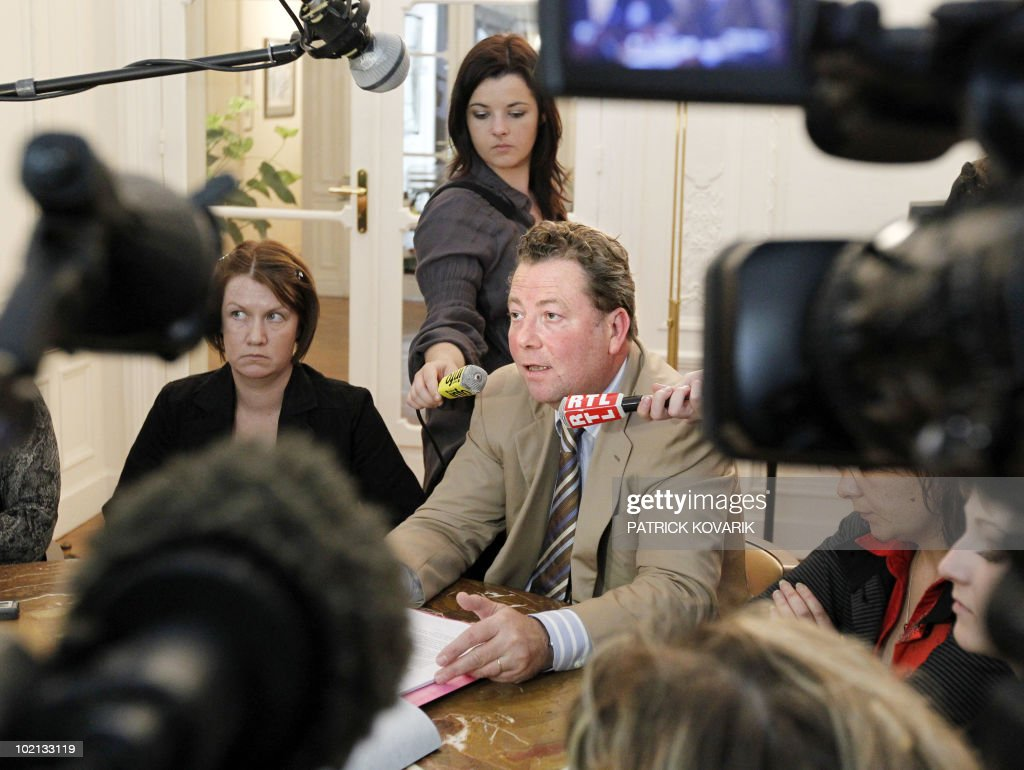Defence lawyer Olivier Morice (C), flanked by a family member of Karachi attack, Magali Drouet (L), answers journalists' questions on June 16, 2010 in Paris, during a press conference. French policemen carried out a search at the end of May 2010 the Head of French Naval Constructions (DCNS) as part of the inquiry on Karachi attack in 2002.