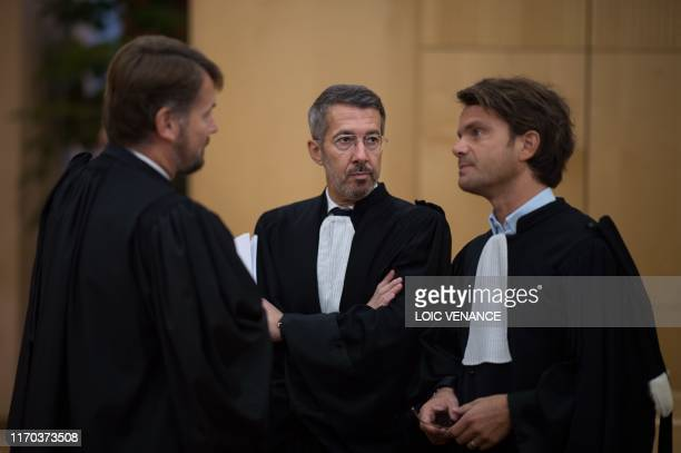 Defence lawyer William Pineau speaks with the lawyer of the victim's family JeanGuillaume Le Mintier on September 23 2019 at the Rennes courthouse...