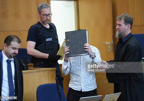 Defence lawyers Serkan Alkan and Martin Heising look on as the Iraqi defendant identified only as Taha alJ believed to have belonged to the Islamic...