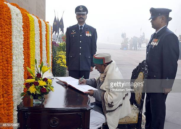 Defence Minister AK Antony writing a massage after paying homage to the martyrs at Amar Jawan Jyoti at India Gate to mark the 'Vijay Divas' on...